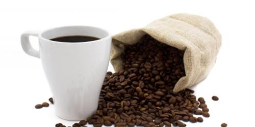 Кофе в зернах с чашкой